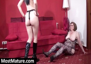 Mature mom in body stocking sucks strapon and