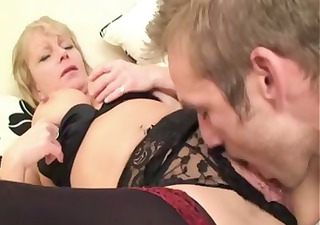 Short-haired mature blonde crawls in with a young
