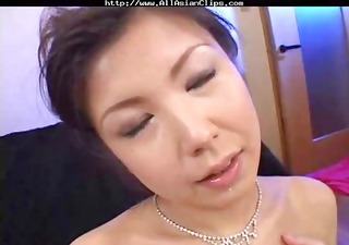 Busty Oriental MILF Asaoka eats three cocks and